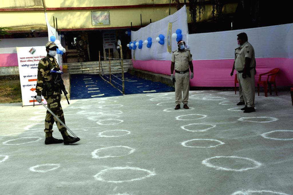 Security personnel guard a polling station during Bihar Legislative Council elections, in Patna on Oct 22, 2020.