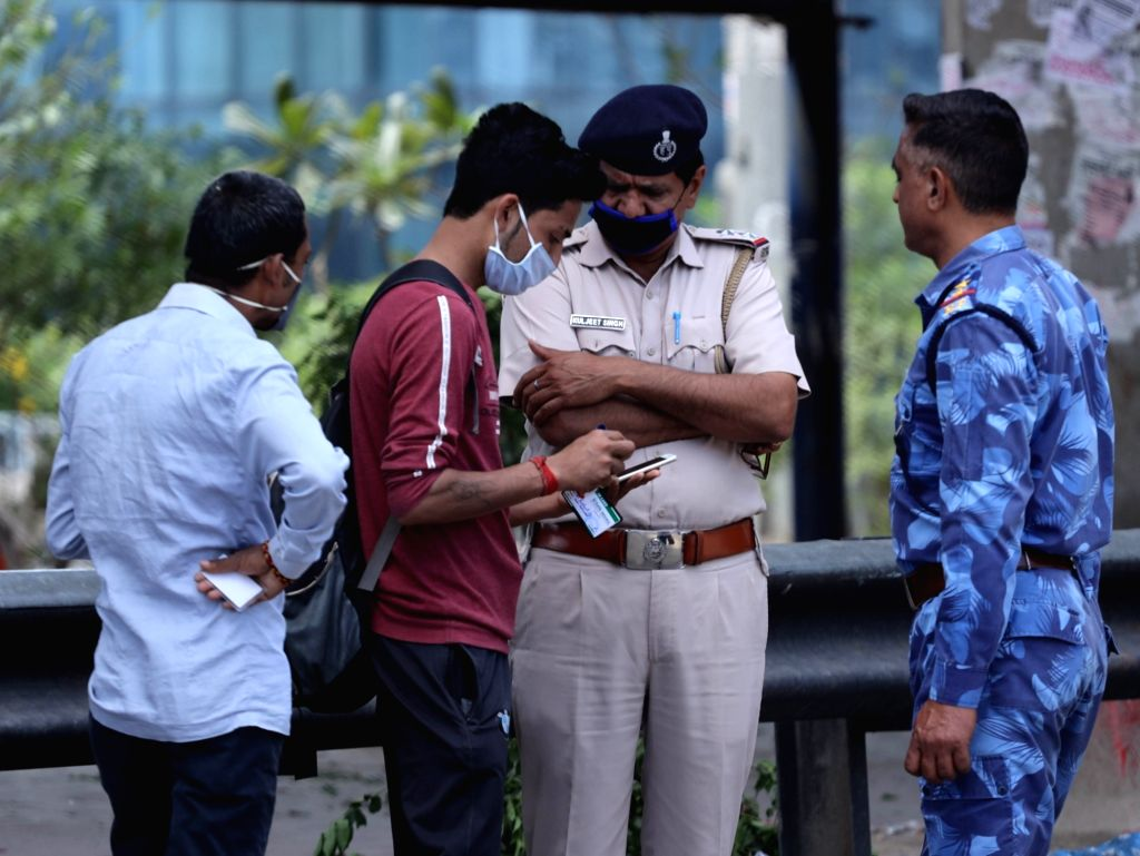 Security personnel intercept a violator at the Delhi-Faridabad Border that has been sealed in the wake of the countrywide lockdown imposed to contain the spread of novel coronavirus, on ...