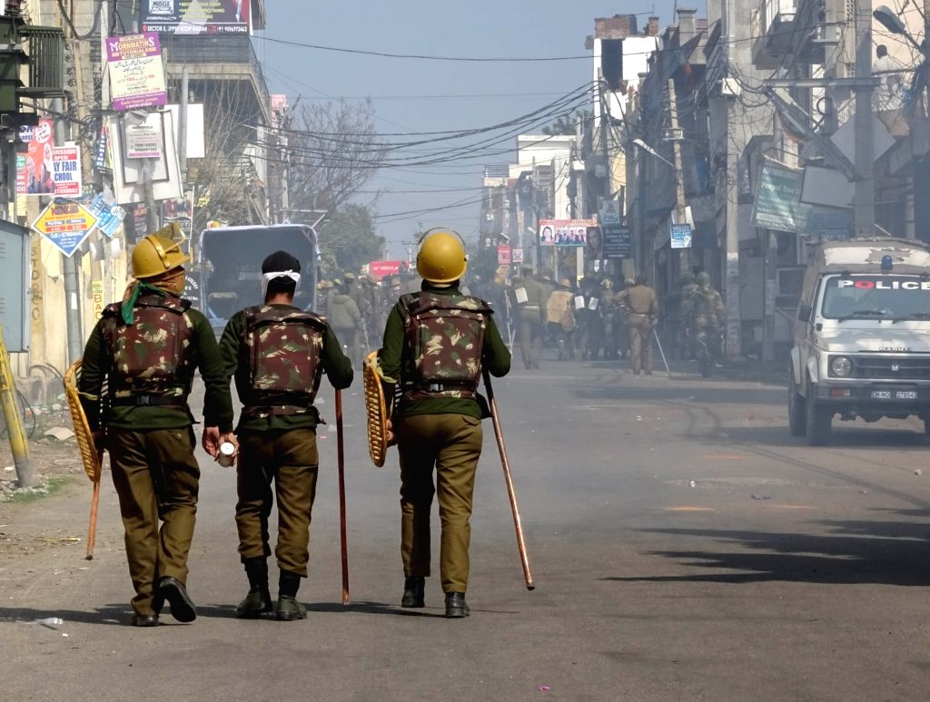 Security personnel man a Jammu road as curfew continued in the city without any relaxation for the second consecutive day on Feb 16, 2019.