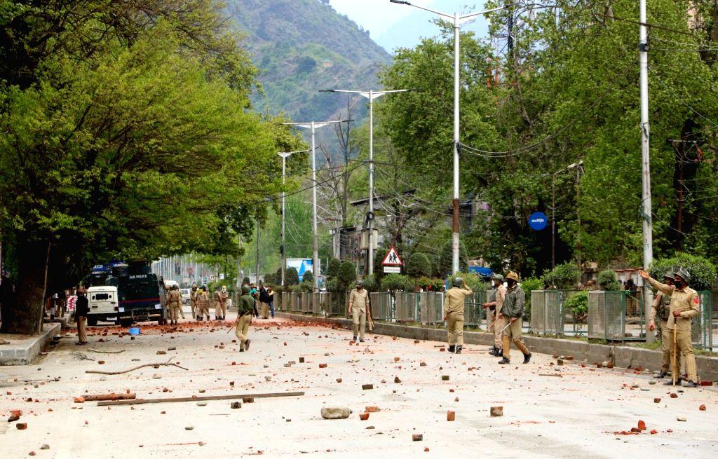 Security personnel man a stone strewn road in Srinagar on April 24, 2017.