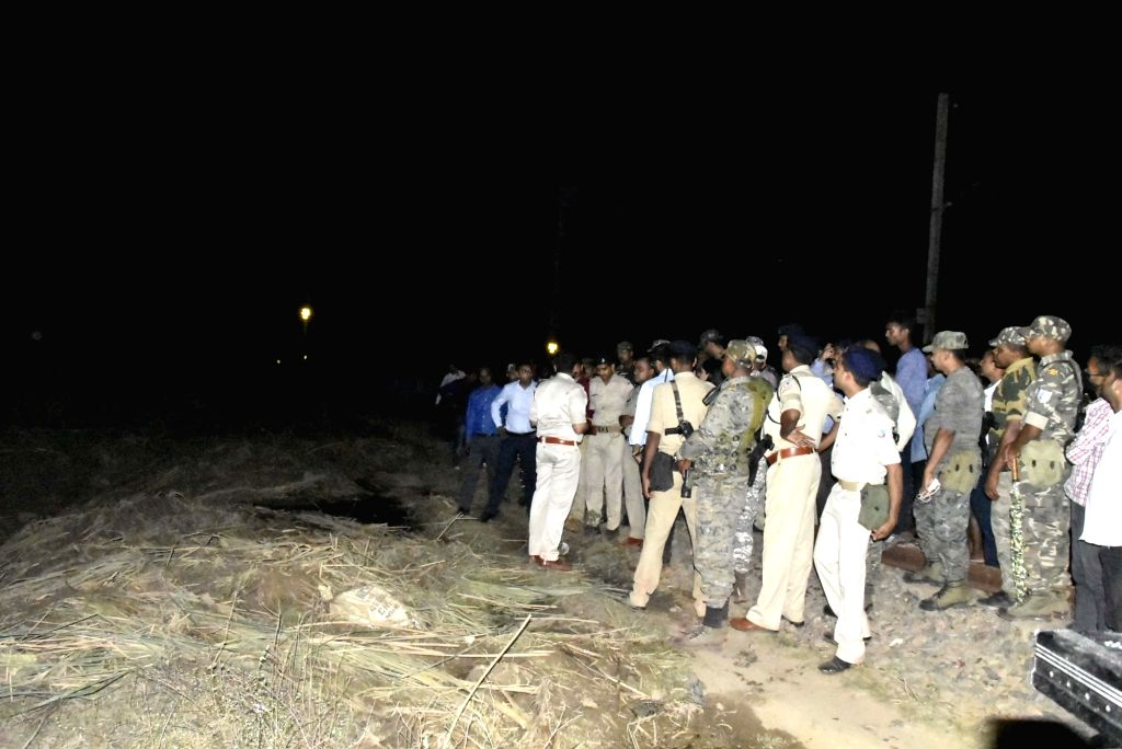 Security personnel near the site where many people are said to be trapped and several vehicles buried after the caustic pond of Hindalco collapsed at Muri, in Jharkhand on April 9, 2019.