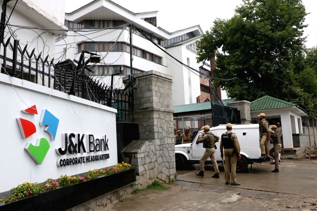 Security personnel outside the J&K Bank where raids by the state Anti-Corruption Bureau (ACB) are underway, in Srinagar on June 8, 2019. Within hours after the Jammu and Kashmir ...
