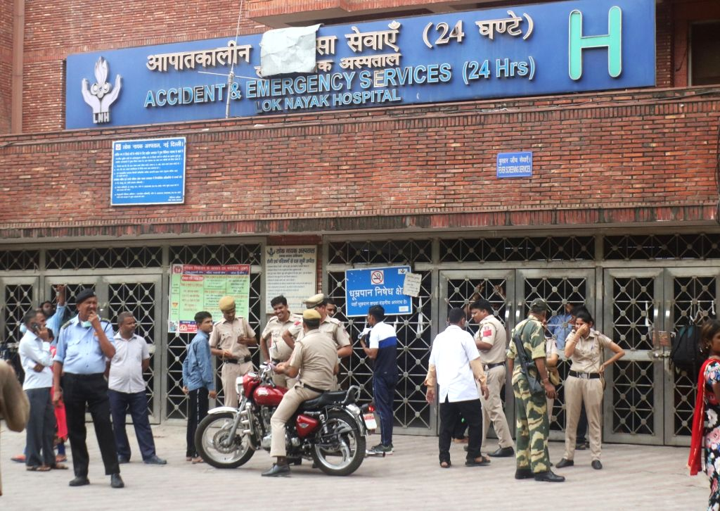 Security personnel outside the Lok Nayak Jai Prakash (LNJP) Hospital where doctors went on a strike as they are protesting against the National Medical Commission (NMC) Bill 2019, in New ...