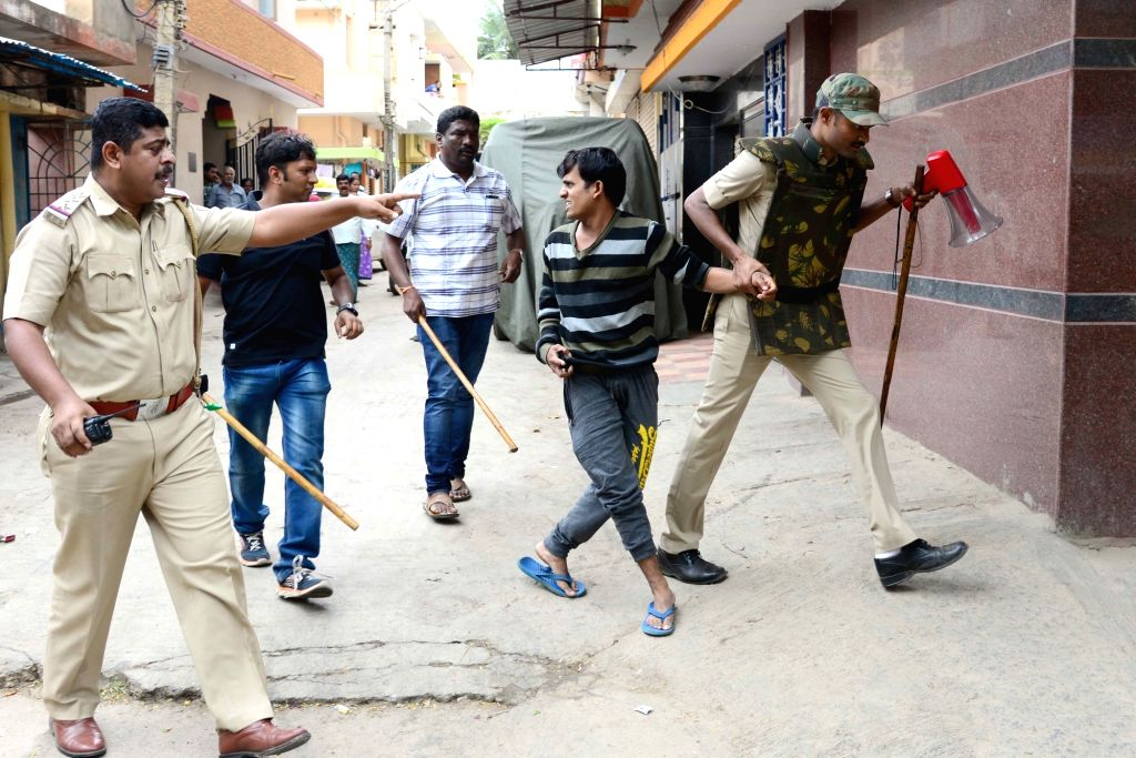 Security personnel patrol on Bengaluru roads on Sept 13, 2016. An uneasy calm prevailed in the city where one person was killed in police firing on Monday night and curfew is in force in ...