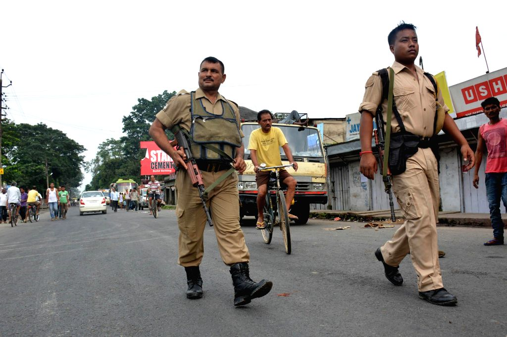 Security personnel patrol on National Highway 37 in Bokakhat of Assam during a bandh called by various organisations against police atrocities on Aug 21, 2014.