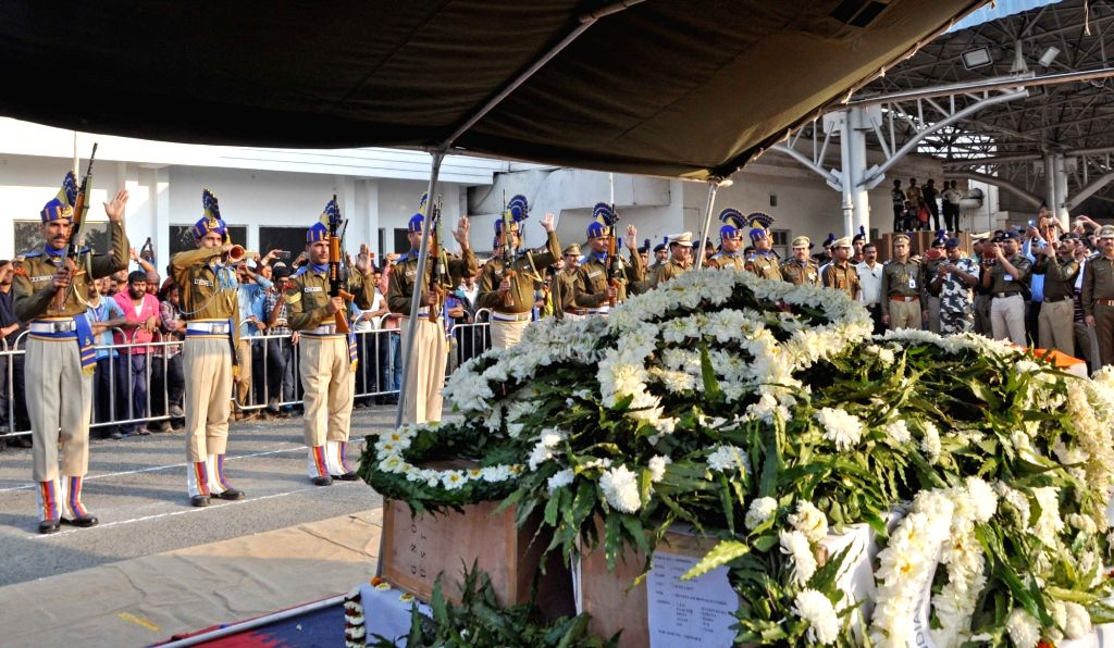 Security personnel pay homage to martyrs Bablu Santra and Sudip Biswaws, who were among the 49 CRPF men killed in 14 Feb Pulwama militant attack arrive at Netaji Subhas Chandra Bose ...