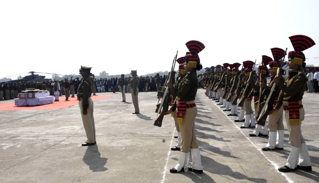 Security personnel pay tributes to martyrs Ratan Kumar Thakur and Sanjay Kumar Sinha, who were among the 45 CRPF personnel killed in 14 Feb Pulwama militant attack, in Patna on Feb 16, 2019. - Kumar Thakur and Sanjay Kumar Sinha