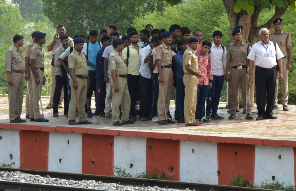 Security personnel round up ticket-less passengers at a Lucknow railway station on May 26, 2016.