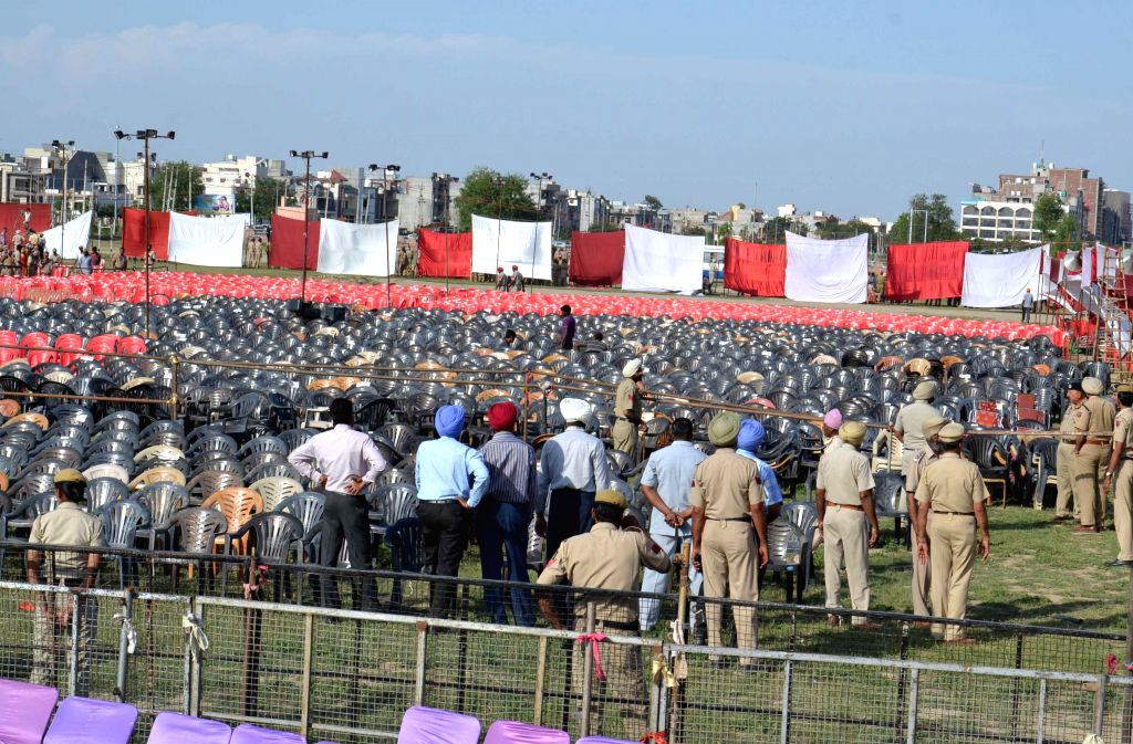 Security personnel sanitise the venue of BJP Prime Ministerial candidate and Gujarat Chief Minister Narendra Modi's rally, Ranjit Avenue Ground of Amritsar on April 24, 2014. Modi is scheduled to ...