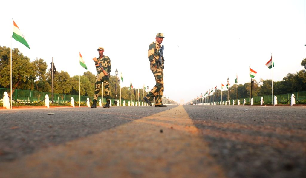 Security personnel stand guard at Rajpath on the eve of 2019 Republic Day celebrations in New Delhi, on Jan 25, 2019.