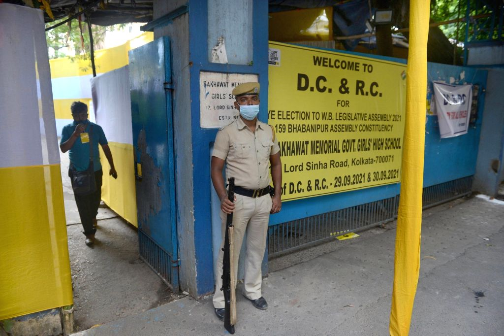 Security personnel stand in front of counting centre on the eve of the counting Bhawanipur by election in Kolkata on Saturday October 02,2021.