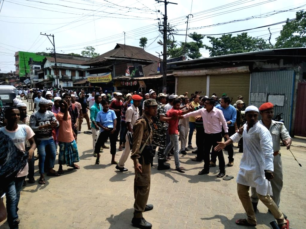 Security personnel try to bring the situation under control after a clash broke out between the people of two communities, in Assam's Hailakandi on May 10, 2019. Curfew has been clamped ...