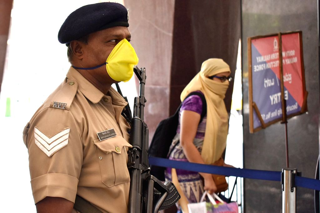 Security personnel wearing mask at City Railway Station amid Coronavirus outbreak, in Bengaluru on Thursday 19 March 2020.