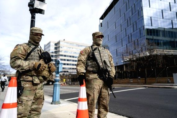 Security staff are seen near the U.S. Capitol building in Washington, D.C., the United States, Jan. 17, 2021.