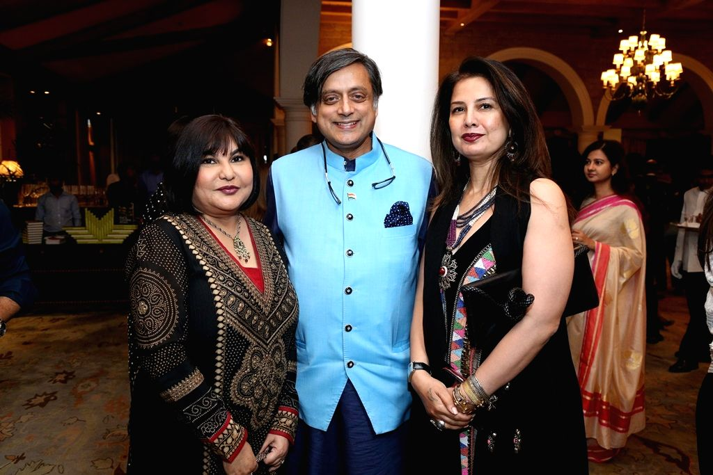 Seema Goswami with Congress leader Shashi Tharoor and fashion designer Ritu Berry at the launch of her book 'Race Course Road' at Taj Mahal Hotel in New Delhi on April 4, 2018. - Shashi Tharoor and Seema Goswami
