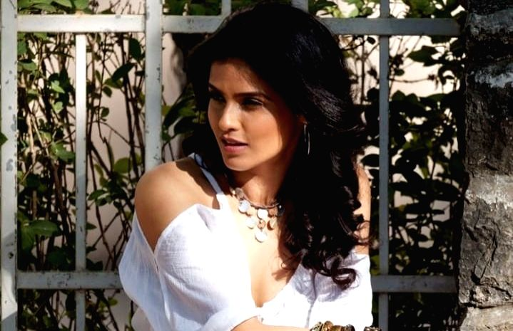 Seema Mishra doesn't mind showing her grey hair . - Seema Mishra
