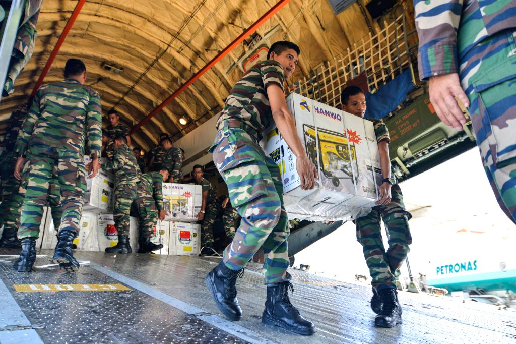 Malaysian soldiers unload relief goods at Subang Air Force Airport, Selangor, Malaysia, Jan. 12, 2015. The relief goods offered by the People's Liberation Army of .