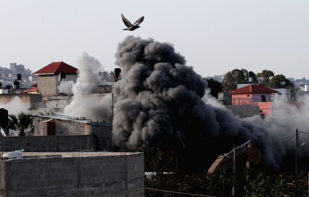 SELFIT, April 24, 2019 - Smoke rises as Israeli forces demolish the residential home of Omar Amin Abu Lila, a Palestinian suspected of killing an Israeli soldier and a civilian in the West Bank in ...