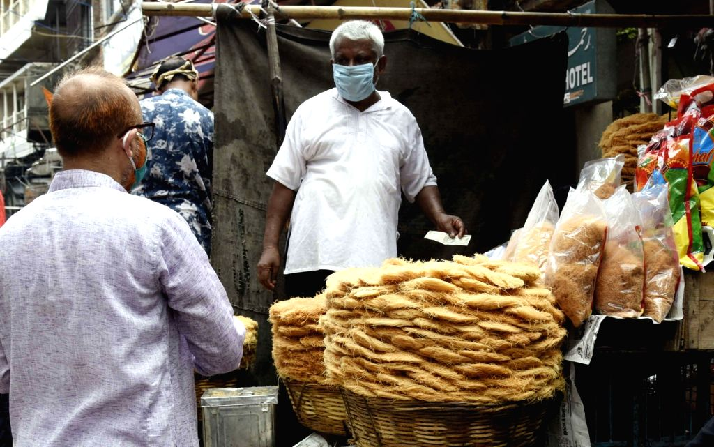 Semolina cakes (used to prepare Sewain, a traditional desert) on sale at a shop at Sabzibagh market on the eve of Eid-Al-Adha celebrations, in Patna on July 31, 2020.