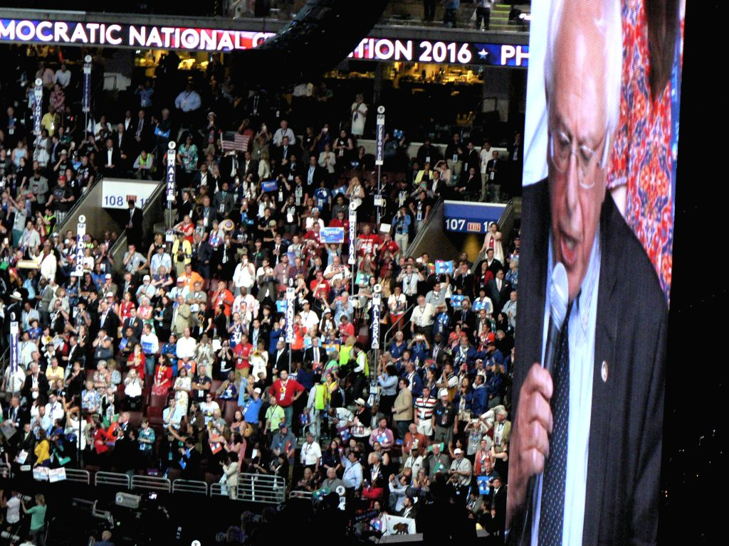 Senator Bernie Sanders seen on a giant TV screen at the Democratic Party Convention in Philadelphia on Tuesday, July 26, 2016, making a proposal to unanimously nominate Hillary Clinton as the ...