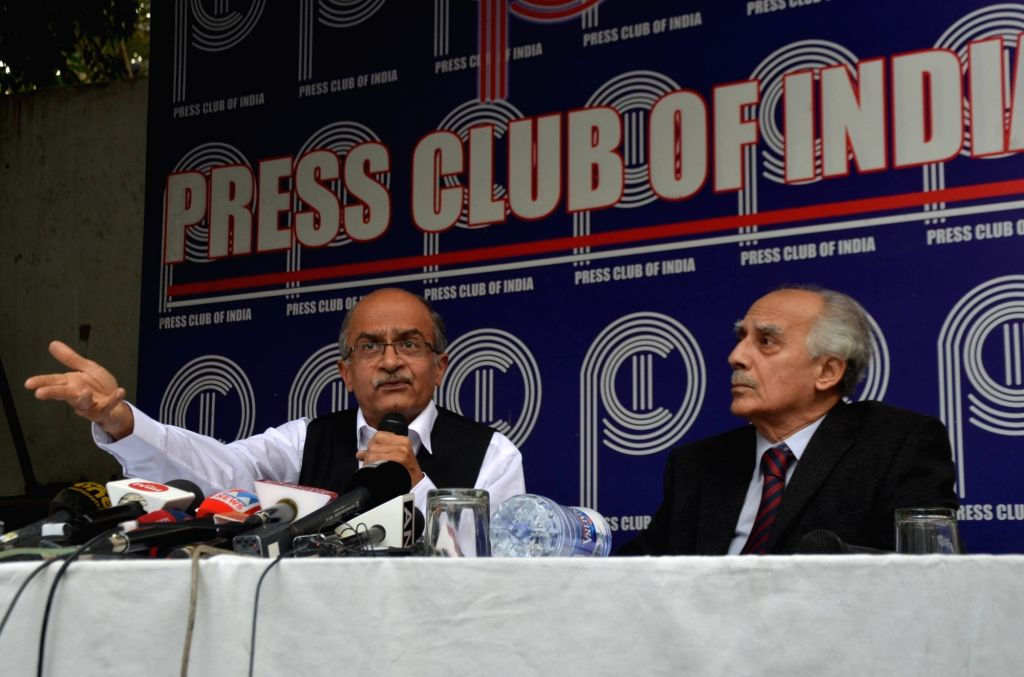 Senior advocate Prashant Bhushan accompanied by former Union Minister Arun Shourie, addresses a press conference on Rafale verdict, in New Delhi on Nov 15, 2019. - Arun Shourie