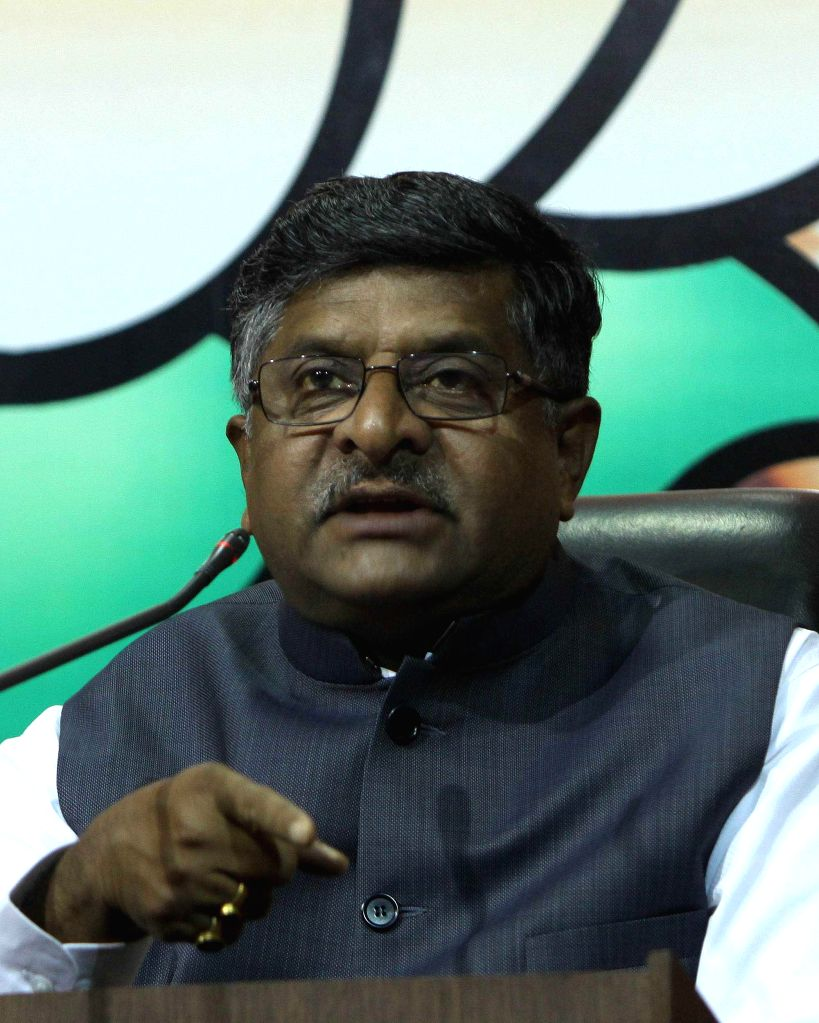 Senior BJP leader Ravi Shankar Prasad addresses a press conference at party headquarters in New Delhi on April 13, 2014.