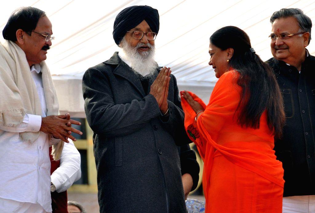Senior BJP Leader Venkaiah Naidu, Punjab Chief Minister Parkash Singh Badal and Chhattisgarh Chief Minister Raman Singh with newly elected Rajasthan Chief Minister Vasundhara Raje during her ... - Parkash Singh Badal, Venkaiah Naidu and Raman Singh