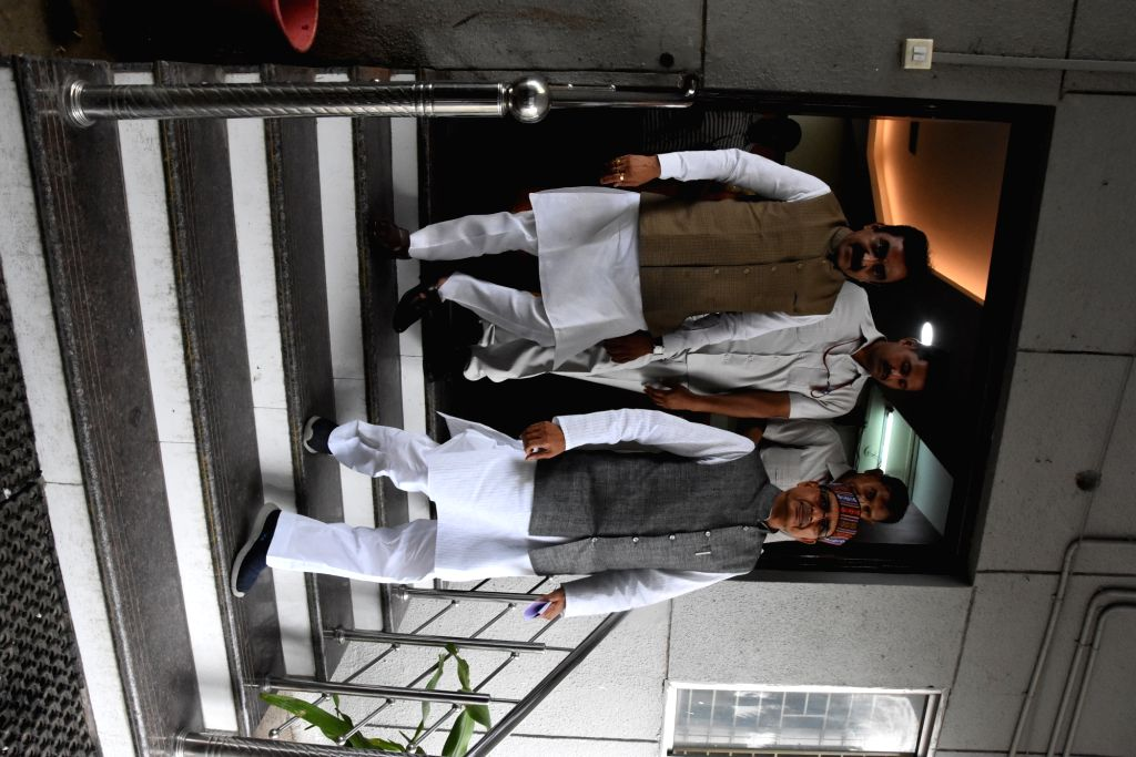 Senior BJP leaders Shivraj Singh Chouhan and Rakesh Singh come out after holding meetings with party MLAs at Madhya Pradesh's party headquarters, in Bhopal on July 25, 2019. This comes after ... - Shivraj Singh Chouhan, Rakesh Singh and Narayan Tripathi