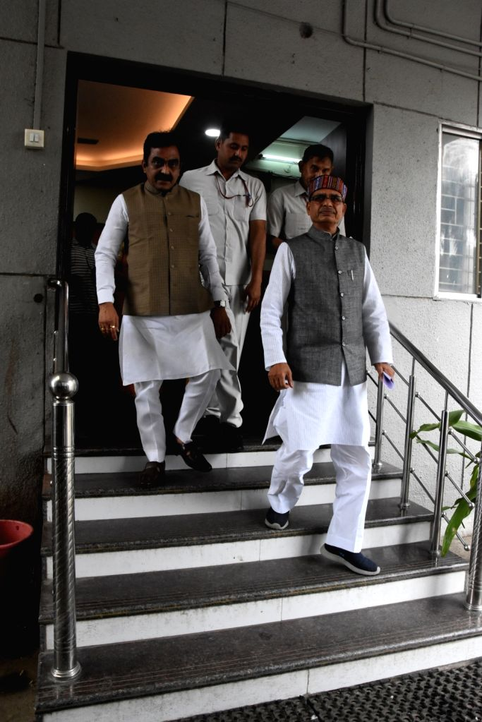 Senior BJP leaders Shivraj Singh Chouhan and Rakesh Singh come out after holding meetings with party MLAs at Madhya Pradesh's partyheadquarters, in Bhopal on July 25, 2019. This comes after ... - Shivraj Singh Chouhan, Rakesh Singh and Narayan Tripathi