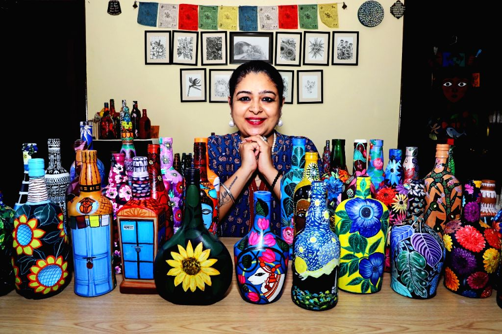 Senior bureaucrat brings out an artist within with her first 'Bottle in Canvas' exhibition.
