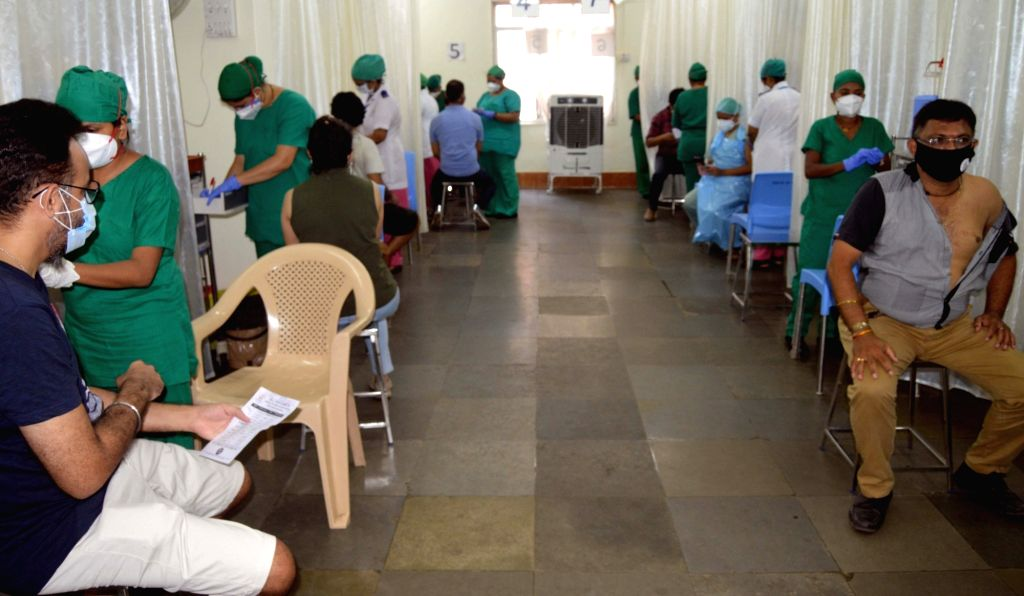 Senior citizens along with age groups from 18-45, at Nair Hospital wait at a vaccinationer to receive scene COVID-19 vaccine shots, in Mumbai on Tuesday May 4th, 2021.