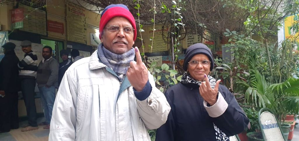 Senior citizens show their inked fingers after casting their votes for the Delhi Assembly elections 2020, on Feb 8, 2020.