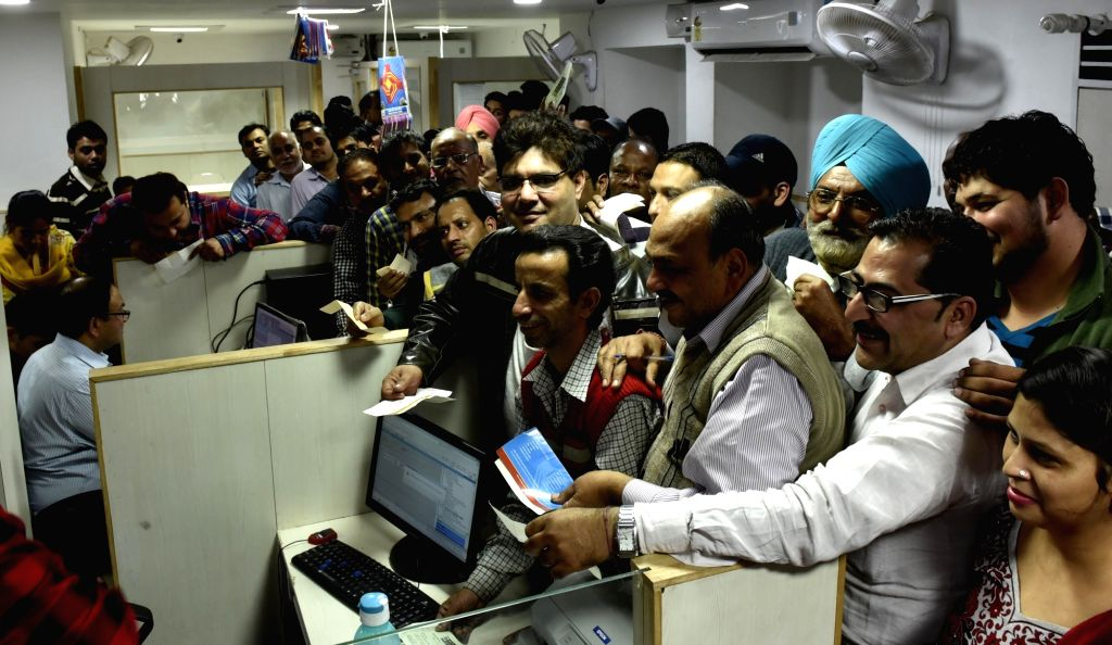 Senior citizens stand in a queue at a bank to exchange old notes in Amritsar on Nov. 19, 2016.