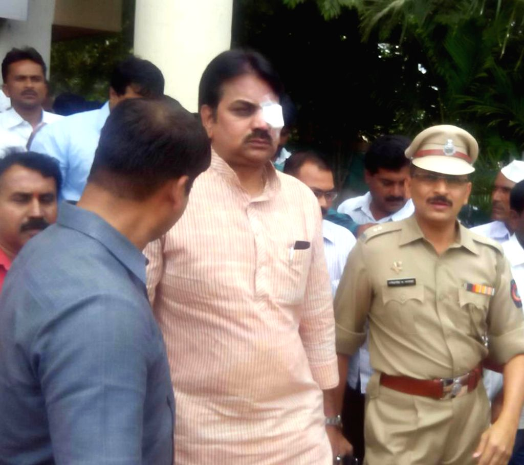 Senior Congress leader and Maharashtra Minister for Cooperatives Harshvardhan Patil comes out of a hospital after treatment in Pune on Aug 8, 2014. Patil suffered an eye injury when some protesting ..