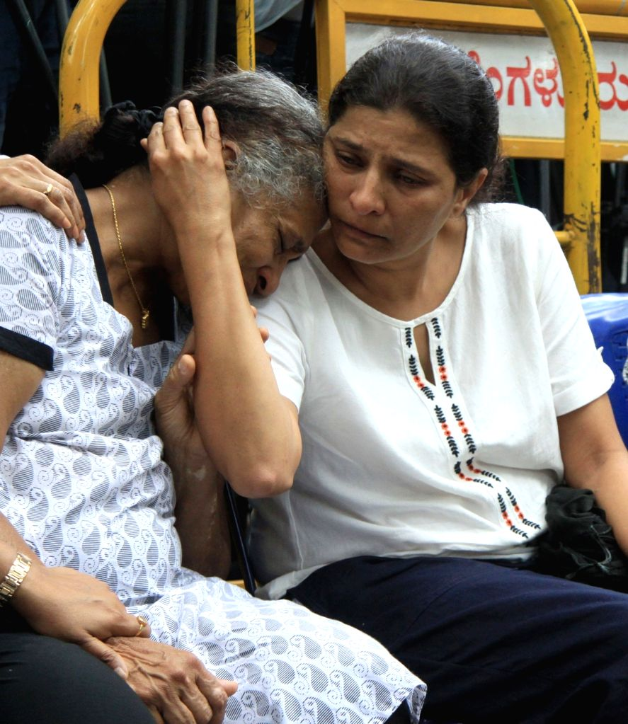 Senior Kannada journalist and social activist Gauri Lankesh's mother Indira Lankesh and sister Kavitha Lankesh mourn her death during the public viewing of the mortal remains of Gauri ...
