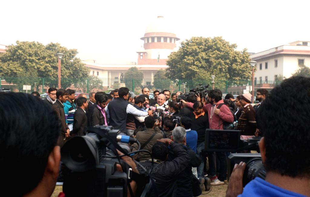 Senior lawyer and BJP leader Nalin Kohli talks to media persons after Supreme Court hearing over the CBI's plea against Kolkata Police chief Rajeev Kumar, in New Delhi on Feb 5, 2019. The ... - Nalin Kohli and Rajeev Kumar