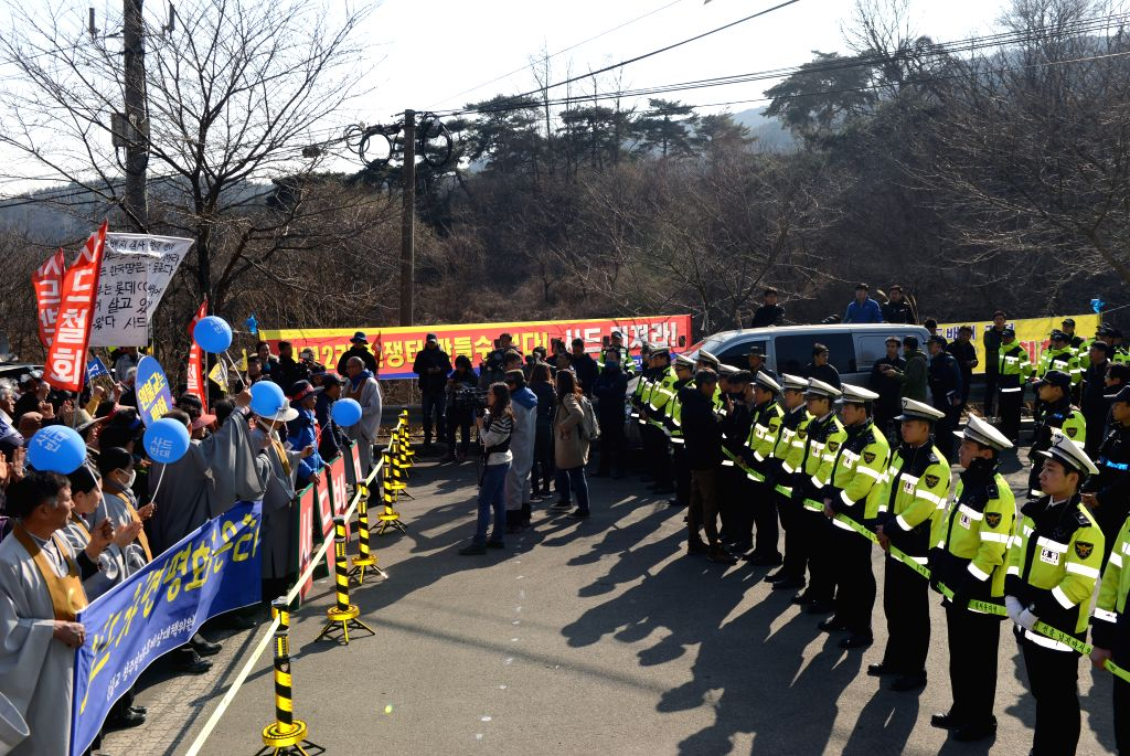 SEONGJU (SOUTH KOREA), March 15, 2017 Protesters confront with policemen during a rally at the entrance to the golf course where the Terminal High Altitude Area Defense (THAAD) system ...