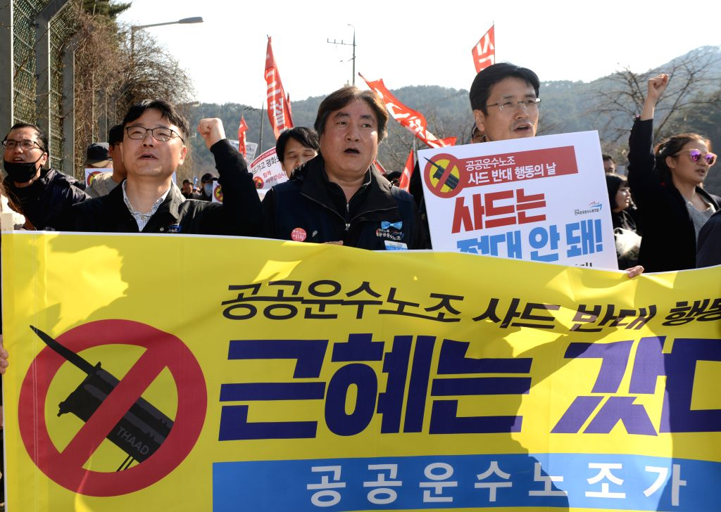 SEONGJU (SOUTH KOREA), March 15, 2017 Protesters shout slogans during a rally near the golf course where the Terminal High Altitude Area Defense (THAAD) system will be deployed in ...