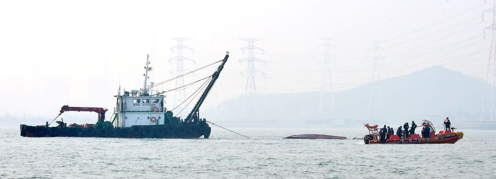 Seoul: A crane vessel is working to retrieve a 9.77-ton chartered fishing boat that capsized and sank due to a collision with a 336-ton tanker on seas near Yeongheung Island, the western port city of Incheon, on Dec. 3, 2017. The accident, which took