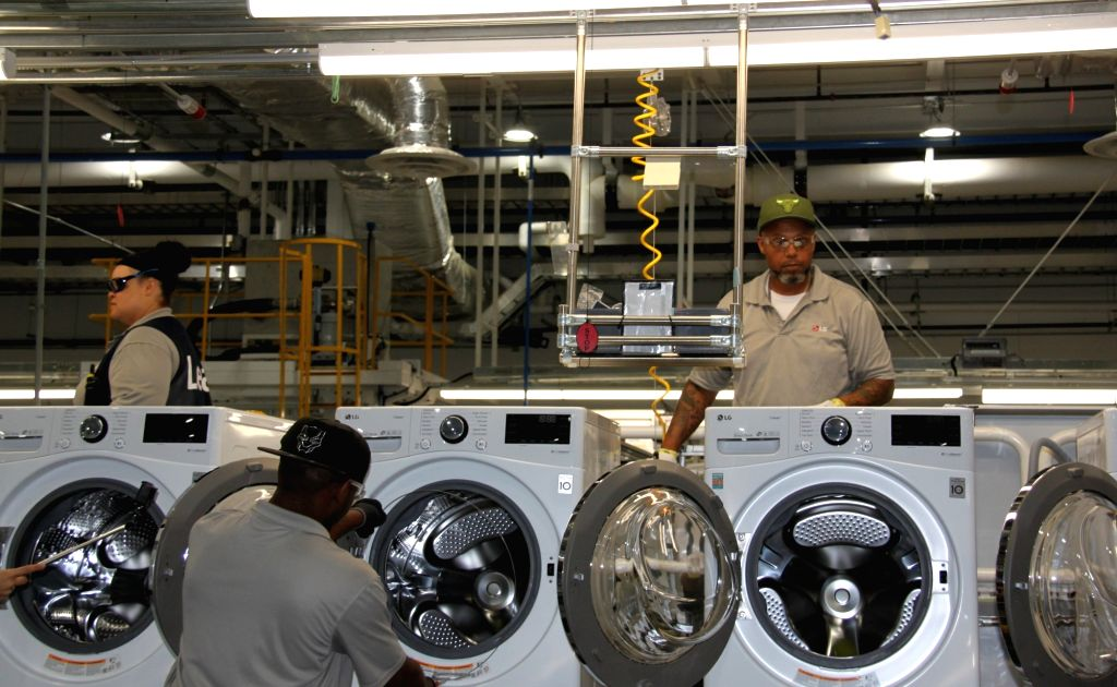 Seoul: American workers produce washing machines at an LG Electronics Inc. plant in Clarksville, Tennessee, on May 29, 2019. LG held a ceremony the same day to mark the completion of its first washing machine plant in the United States.(Yonhap/IANS)