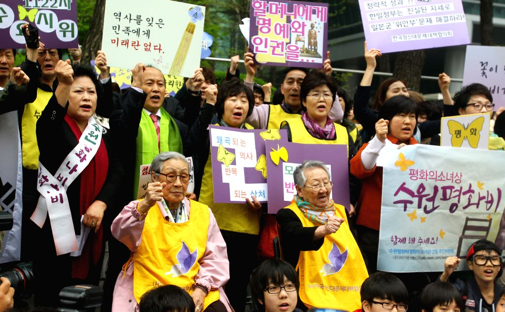 Two former comfort women participate in a protest to demand that the Japanese government acknowledge its legal responsibility for the wartime crime in Seoul, capital