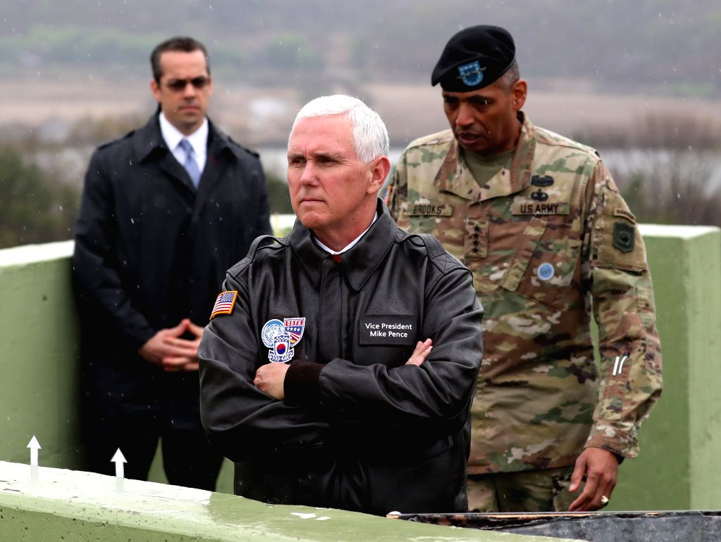 SEOUL, April 18, 2017 - U.S. Vice President Mike Pence (Front) visits the Observation Post Ouellette in the Demilitarized Zone (DMZ), near the truce village of Panmunjom, South Korea, on April 17, ...