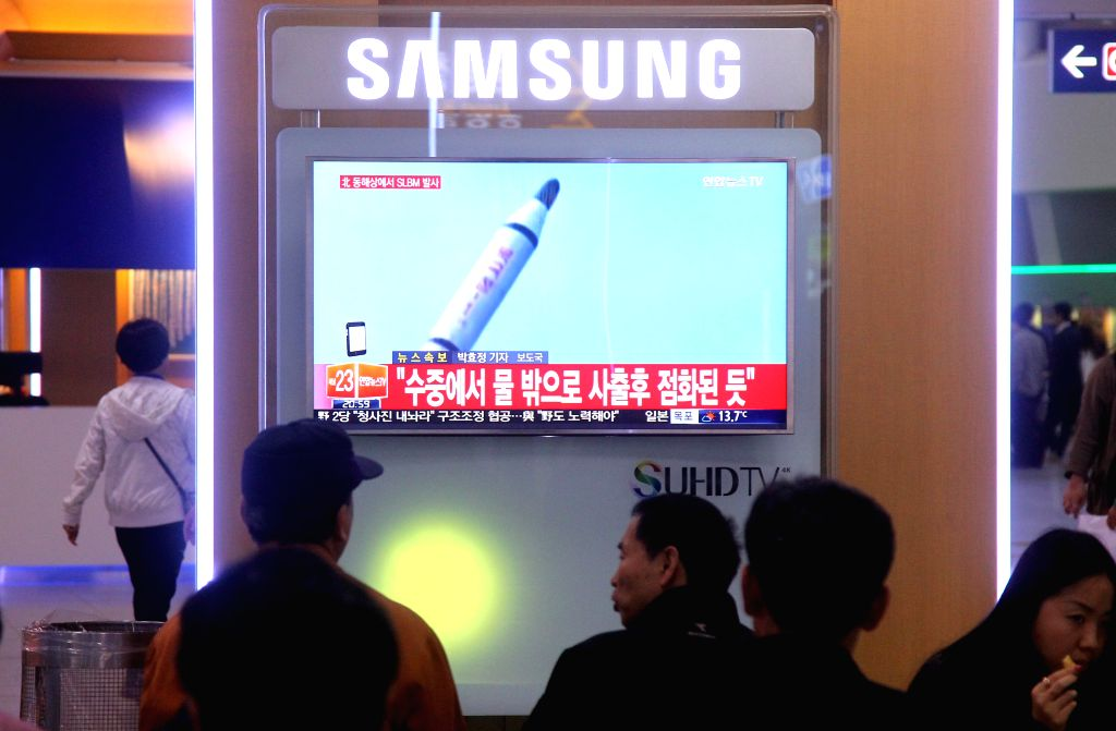 SEOUL, April 23, 2016 - People watch a screen displaying news of the test-firing of a submarine-launched ballistic missile (SLBM) by the Democratic People's Republic of Korea (DPRK), at a railway ...