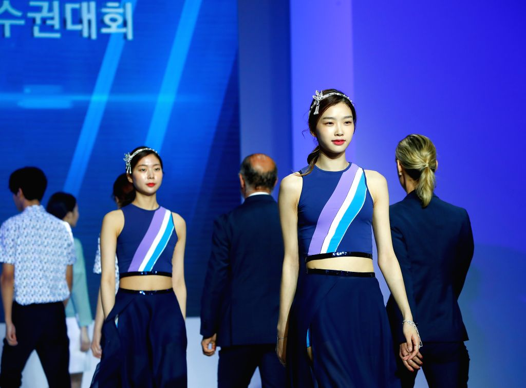 SEOUL, April 24, 2019 - Models show the uniforms of 2019 Gwangju FINA World Championships in Seoul, capital of South Korea, April 24, 2019.