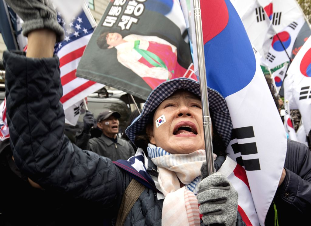 SEOUL, April 6, 2018 - Supporters of impeached South Korean President Park Geun-hye gather outside Seoul Central District Court in Seoul, South Korea, on April 6, 2018. Impeached South Korean ...