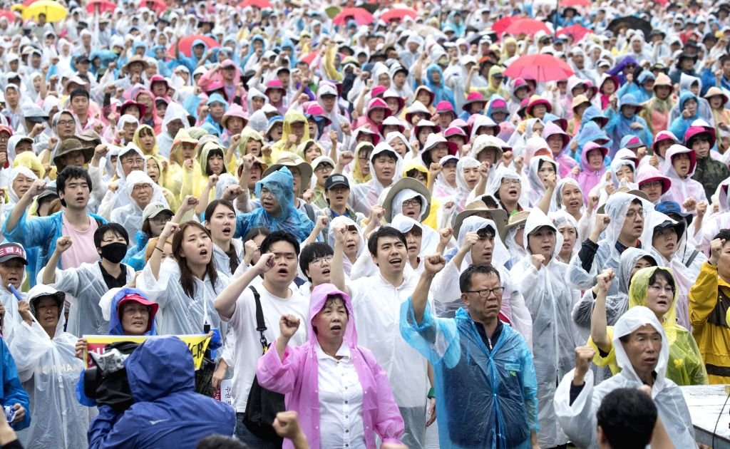SEOUL, Aug. 15, 2017 - Demonstrators shout slogans during a protest in Seoul, South Korea, on Aug. 15, 2017. South Korean people took to the streets in central Seoul on Tuesday to demand the ...