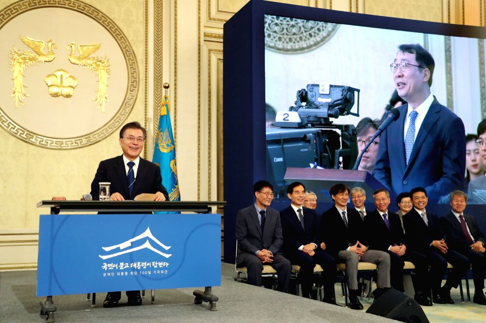 SEOUL, Aug.17, 2017 - South Korean President Moon Jae-in (L) speaks during a press conference marking his first 100 days in office in Seoul, South Korea, on Aug. 17, 2017.