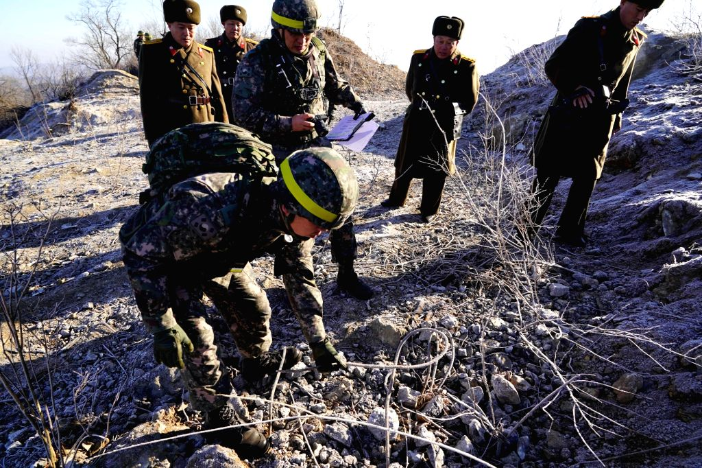 SEOUL, Dec. 13, 2018 - In this handout photo provided by South Korea's Ministry of National Defence, South Korean soldiers conduct onsite verifications at DPRK guard posts within the Demilitarized ...