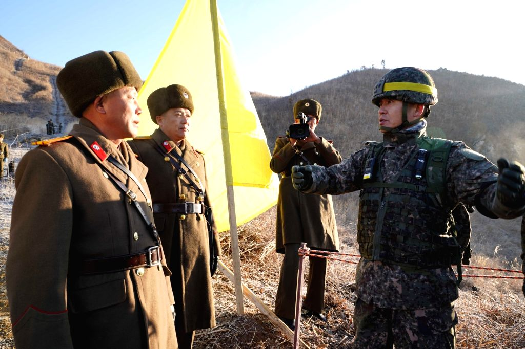 SEOUL, Dec. 13, 2018 - In this handout photo provided by South Korea's Ministry of National Defence, soldiers of South Korea and the Democratic People's Republic of Korea (DPRK) greet each other ...