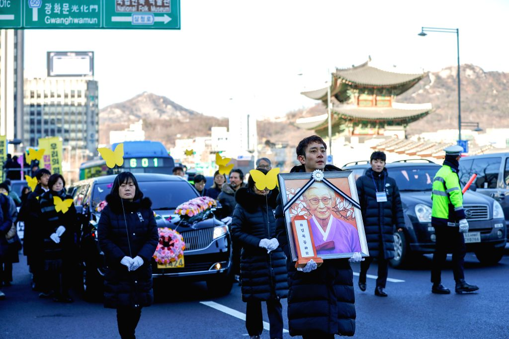 SEOUL, Feb. 1, 2019 - Participants of the funeral ceremony of Kim Bok-dong, a symbolic South Korean victim who was forced into sex slavery for Japan's military brothels during World War II, pass by ...